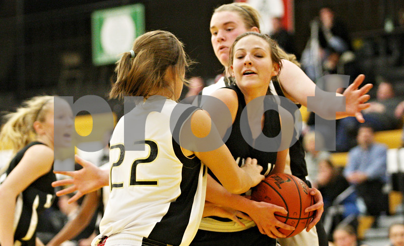 Rob Winner – rwinner@daily-chronicle.com<br /> <br /> Sycamore's Ashley LeClair (22) reaches for a ball controlled by Kaneland's Marina Schaefer during the second quarter on Friday December 10, 2010 in Sycamore, Ill.