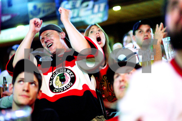 Beck Diefenbach  -  bdiefenbach@daily-chronicle.com<br /> <br /> Michael Gentile, of DeKalb, reacts after the Philadelphia Flyers score a goal against the Chicago Blackhawks during the first period of Game 6 of the Stanley Cup Finals at Lord Stanely's Bar in DeKalb, Ill., on Wednesday June 9, 2010.