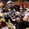 Kyle Bursaw – kbursaw@daily-chronicle.com<br /> <br /> Montini's Franklin Bruscianelli (46) forces Kaneland's Tyler Callaghan (6) to fumble in the third quarter. The Montini Broncos defeated the Kaneland Knights 27-14 at Kaneland High School on Saturday, Nov. 20, 2010 in Maple Park, Ill.