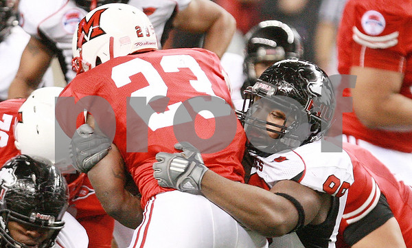 Kyle Bursaw – kbursaw@daily-chronicle.com<br /> <br /> Northern Illinois defensive tackle Nabal Jefferson (99) brings down Miami (OH) running back Tracy Woods during the first half of the MAC Championship game between the Northern Illinois Huskies game and the Miami (Ohio) Redhawks at Ford Field in Detroit, Mich. on Friday, Dec. 3, 2010.