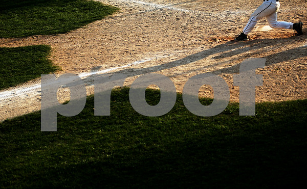 Beck Diefenbach  -  bdiefenbach@daily-chronicle.com<br /> <br /> Sycamore pitcher Nick Bridge (9) swings at the ball during the the sixth inning of the game against Batavia at Sycamore Park in Sycamore, Ill., on Wednesday April 21, 2010. Batavia defeated Sycamore 4 to 2.