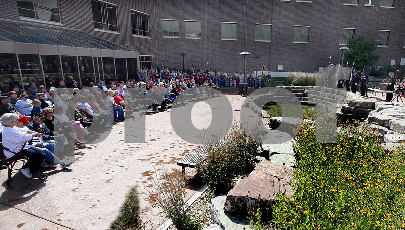 Wendy Kemp - For The Daily Chronicle<br /> People gather for the 911 Memorial Service in the healing garden of Kishwaukee Hospital on Saturday.<br /> DeKalb 9/11/10