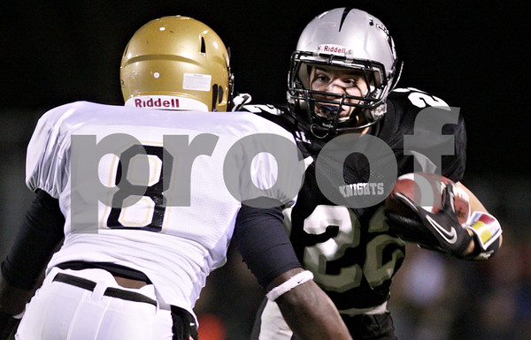 Rob Winner – rwinner@daily-chronicle.com<br /> <br /> Sycamore's Anthony Patitu looks to tackle Kaneland's Quinn Buschbacher during the first quarter of their game in Maple Park, Ill. on Friday October 15, 2010.