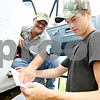 Rob Winner – rwinner@daily-chronicle.com<br /> <br /> William Henley (left) and Mitchell Hendrickson, of Hendrickson Flying Service located in Rochelle, check their maps of local farm fields while spraying fungicide near Fenstermaker and Barber Greene roads in Cortland Township on Friday July 23, 2010.