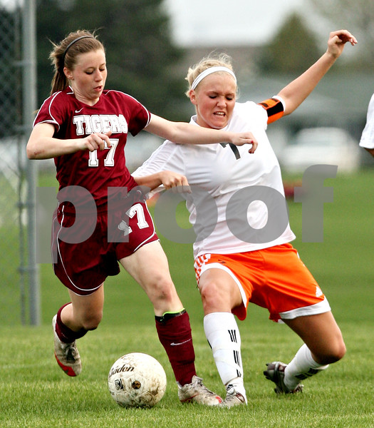 Beck Diefenbach  -  bdiefenbach@daily-chronicle.com<br /> <br /> DeKalb's Lindsey Adshade (7, right) and North's Ashley Auble (17) fight for the ball during the second half of the game at DeKalb High School in DeKalb, Ill., on Monday April 12, 2010. Plainfield North defeated Dekalb 4 to 1.