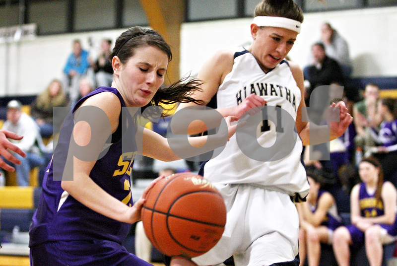 Rob Winner – rwinner@daily-chronicle.com<br /> <br /> Serena's Jordan Weygand (left) and Hiawatha's Sarah Schmidt collide while trying to control a ball in the first quarter in Kirkland, Ill. on Monday December 6, 2010.