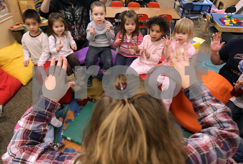 Kyle Bursaw – kbursaw@daily-chronicle.com<br /> <br /> Tina Cliffe, a head teacher at the Children's Learning Center, leads her group of 2- and 3-year-olds in songs before transitioning to lunch on Thursday, Dec. 9, 2010. The Children's Learning Center, located in DeKalb, now has a quality star rating of three.