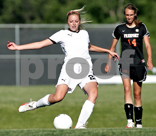 Beck Diefenbach  -  bdiefenbach@daily-chronicle.com<br /> <br /> Sycamore's Rachel Stueber (22, left) kicks her second of three goals during the first half of the IHSA Class 2A sectional final game against Freeport at Hampshire High School in Hampshire, Ill., on Friday May 28, 2010.