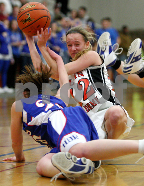 Rob Winner – rwinner@daily-chronicle.com<br /> Hinckley-Big Rock's Alyssa Baunach (left) tries to knock the ball away from Lauren Steimle during the first half of Thursday night's sectional game against Elgin Academy. Hinckley-Big Rock defeated Elgin Academy, 62-35.