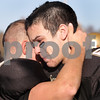 Kyle Bursaw - kbursaw@daily-chronicle.com<br /> <br /> Spartans Chase Ramer, left, and Matt Copple hug before walking off of the field following Sycamore's 28-7 loss to  Montini in Sycamore, Ill. on Nov. 6, 2010.