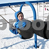 Rob Winner – rwinner@daily-chronicle.com<br /> During lunch recess at Gwendolyn Brooks Elementary School in DeKalb, Ill. on Tuesday January 19, 2010, first grader Thomas Clark, 7, enjoys himself on one of the swings on the playground.