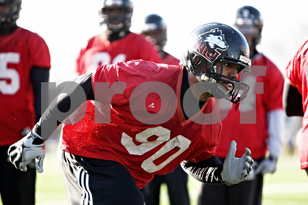 Rob Winner – rwinner@daily-chronicle.com<br /> <br /> Alan Baxter runs through a drill during NIU football practice on Tuesday March 23, 2010 in DeKalb, Ill.
