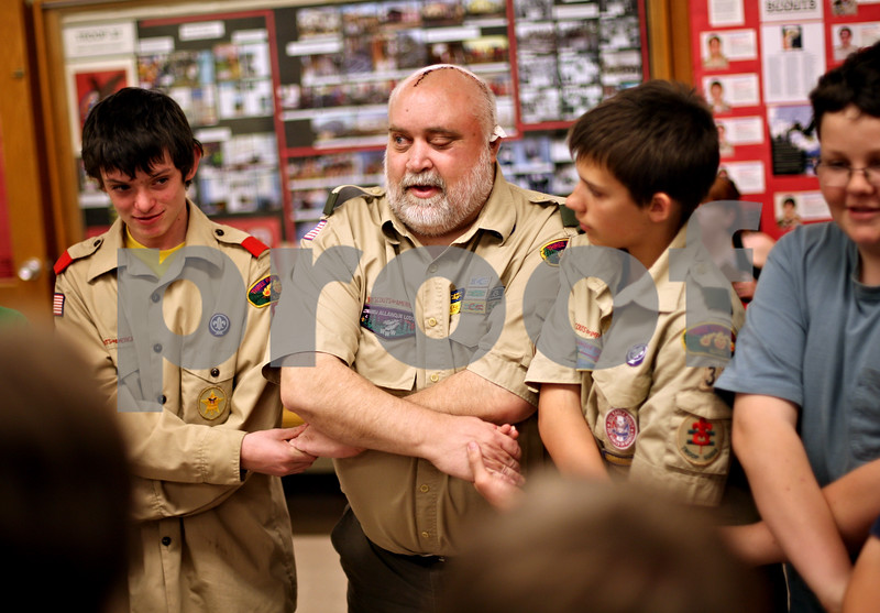 "Beck Diefenbach  -  bdiefenbach@daily-chronicle.com<br /> <br /> Scoutmaster Cliff Golden holds hands in the closing ceremony of a Troop 33 meeting at First Lutheran Church in DeKalb, Ill., on Monday May 3, 2010. ""The best medicine I have is right here, being with you [scouts],"" Golden said."