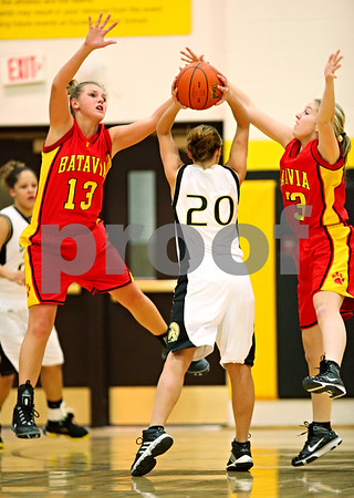 Beck Diefenbach  -  bdiefenbach@daily-chronicle.com<br /> <br /> Batavia's Hannah Scheigert (33, right) and Sara Fruendt (13, left) try to block a shot by Sycamore's Ashley Berlinski (20) during the first quarter of the game at Sycamore High School in Sycamore, Ill on Tuesday Jan. 5, 2009. Sycamore defeated Batavia 35 to 25.