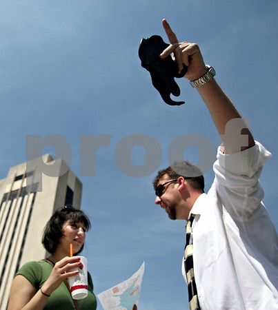 Rob Winner – rwinner@daily-chronicle.com<br /> <br /> Don Transue (right), of Batavia, holds up an empty gun holster while talking to Maria Torres, of Elgin, outside the Holmes Student Center at Northern Illinois University in DeKalb, Ill. on Wednesday April 14, 2010.