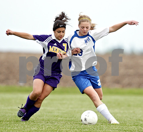 Beck Diefenbach  -  bdiefenbach@daily-chronicle.com<br /> <br /> Mendota Brianna Correa (7, left) and Hinckley-Big Rock Sarah Paver (23) battle for the ball during the first half of the game at H-BR in Hinckley, Ill., on Tuesday May 18, 2010.