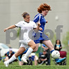 Beck Diefenbach  -  bdiefenbach@daily-chronicle.com<br /> <br /> Sycamore's Michelle Doran (10, left) battles for the ball with Rosary's Courtney Bila (25) during the second half of the IHSA Class 2A Hampshire Sectional Semi-final game against Rosary at Hampshire High School in Hampshire, Ill., on Tuesday May 25, 2010. Sycamore defeated Rosary 3 to 1.