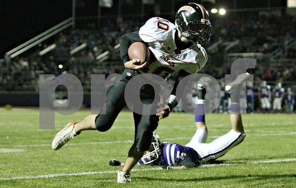 Rob Winner – rwinner@daily-chronicle.com<br /> <br /> DeKalb quarterback Brian Sisler carries the ball and runs it in for a touchdown during the second quarter in Rochelle, Ill.  on Friday October 22, 2010.