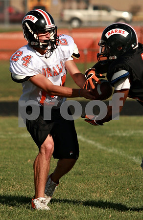 Beck Diefenbach  -  bdiefenbach@daily-chronicle.com<br /> <br /> DeKalb quarterback Brian Sisler gives a hand off during practice at DeKalb High School in DeKalb, Ill., on Thursday Sept. 9, 2010.