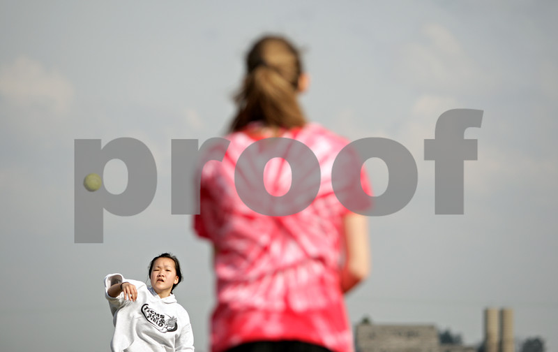 Beck Diefenbach  -  bdiefenbach@daily-chronicle.com<br /> <br /> Indian Creek freshman Khloe Gordon (left) throws the ball during warmups during practice at Indian Creek High School in Shabbona, Ill., on Friday March 19, 2010.