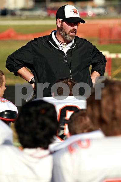 Beck Diefenbach  -  bdiefenbach@daily-chronicle.com<br /> <br /> DeKalb football head coach Marty Sanders talks to his players after practice at DeKalb High School in DeKalb, Ill., on Thursday Sept. 9, 2010.