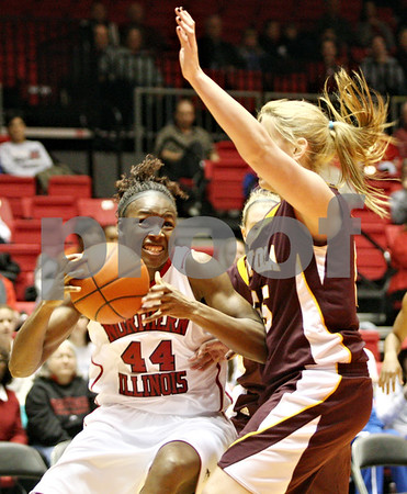 Rob Winner – rwinner@daily-chronicle.com<br /> <br /> Northern Illinois center Ebony Ellis (44) is fouled on her way to the basket by Loyola center Brittany Boeke during the first half in DeKalb, Ill. on Tuesday, Dec. 28, 2010.