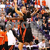 Beck Diefenbach - bdiefenbach@daily-chronicle.com<br /> <br /> DeKalb's Jordan Threloff (left) is welcomed to the floor by Anthony Baker (23, right) before the start of the sectional championship game against Oswego at Hampshire High School in Hampshire, Ill., on Friday March 12, 2010. Oswego defeated DeKalb 57 to 51, ending the Barb's season.