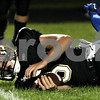 Rob Winner - rwinner@daily-chronicle.com<br /> <br /> Spartans quarterback Ryan Bartels is stunned after a hard hit in the first half of Friday night's game against Burlington Central on Friday September 3, 2010 in Sycamore, Ill.