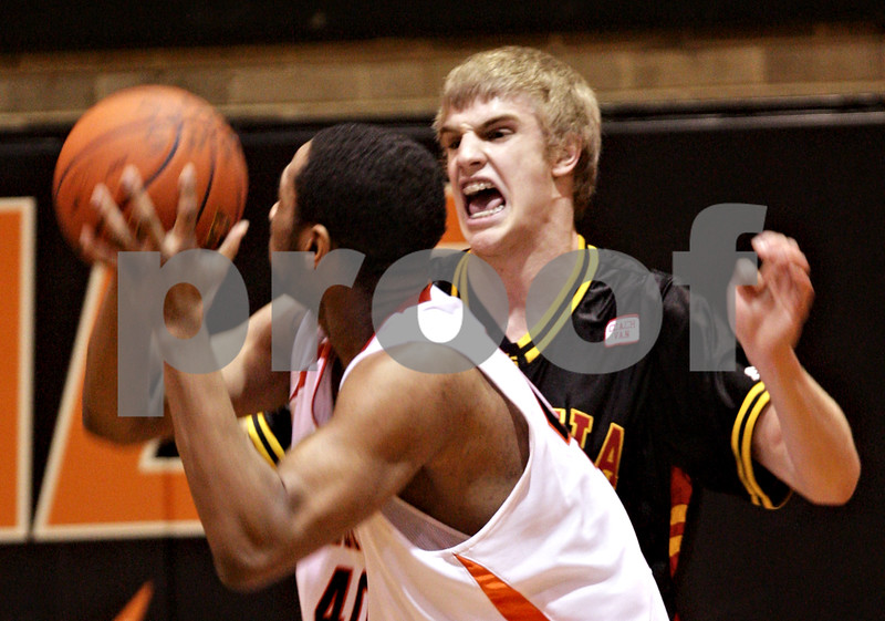 Beck Diefenbach  -  bdiefenbach@daily-chronicle.com<br /> <br /> Batavia Elliot Vaughn (50, right) defends DeKalb's Craig Lane (40) during the second quarter of the game at DeKalb High School in DeKalb, Ill., on Tuesday Jan. 26, 2010.