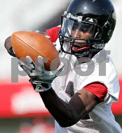 Beck Diefenbach - bdiefenbach@daily-chronicle.com<br /> <br /> Northern Illinois' Martel Moore catches a pass during the first practice at Huskie Stadium in DeKalb, Ill., on Thursday Aug. 5, 2010.
