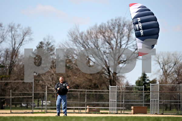 "Rob Winner – rwinner@daily-chronicle.com<br /> <br /> It's addictive. I'll tell you that,"" said Craig Donnelly, of DeKalb, while flying one of his kites during Kites Over Sycamore on Saturday April 3, 2010 at Sycamore Park Annex. Donnelly fell into the hobby after attending a kite festival last year."