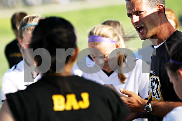 Beck Diefenbach  -  bdiefenbach@daily-chronicle.com<br /> <br /> Sycamore head coach Dave Lichamer talks to his players during half time of the   IHSA Class 2A sectional final game against Freeport at Hampshire High School in Hampshire, Ill., on Friday May 28, 2010.