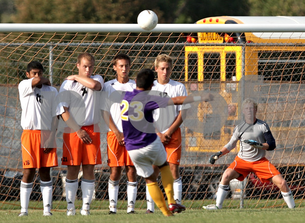 Beck Diefenbach - bdiefenbach@daily-chronicle.com<br /> <br /> The soars over DeKalb players following a free kick by Hononegah during the first half of the game at DeKalb High School in DeKalb, Ill., on Tuesday Aug. 24, 2010. DeKalb and Hononegah tied 1 to 1.