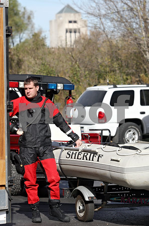 Rob Winner – rwinner@daily-chronicle.com<br /> <br /> A dive-rescue member from the St. Charles Fire Department prepares to search the Kishwaukee River near the Elks Lodge in DeKalb, Ill. on Thursday October 21, 2010.