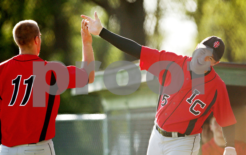 Beck Diefenbach  -  bdiefenbach@daily-chronicle.com<br /> <br /> Indian Creek's Ian Horn (5, right) congratulates Reece Bend (11) after he scored a run during the top of the fifth inning of the game against Hinckley-Big Rock in Big Rock, Ill., on Tuesday April 27, 2010. Indian Creek defeated H-BR 9 to 8.