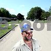 Rob Winner – rwinner@daily-chronicle.com<br /> <br /> Perry Maness stands in the middle of Perry Court in Sycamore, Ill. on Thursday July 29, 2010. George Maness Sr., Perry's father, was the developer of Somonauk Meadows subdivision in Sycamore, Ill. and he named the streets after his family.