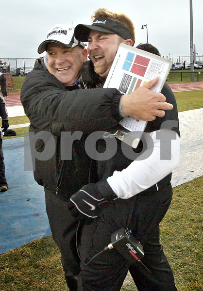 Wendy Kemp - For The Chronicle<br /> <br /> Assistant coaches Joe Thorgesen (left) and Keith Snyder celebrate after winning Saturday's playoff game against Vernon Hills High School.