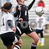 Beck Diefenbach  -  bdiefenbach@daily-chronicle.com<br /> <br /> Indian Creek's Lindsay Craig (8, right) keeps control of the ball during the first half of the game at Hiawatha High School in Kirkland, Ill., on Thursday March 25, 2010.