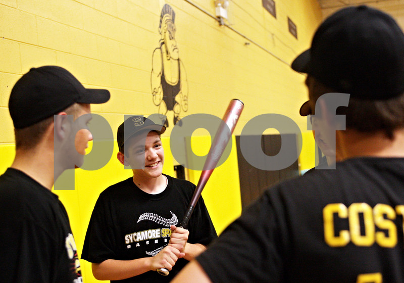 Beck Diefenbach  -  bdiefenbach@daily-chronicle.com<br /> <br /> Sycamore's Jake Dugger chats with teammates during practice at Sycamore High School in Sycamore, Ill., on Monday May 24, 2010.