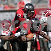 Rob Winner - rwinner@daily-chronicle.com<br /> <br /> Northern Illinois running back Chad Spann breaks through the Temple defense for the Huskies' fourth touchdown during the fourth quarter of their game in DeKalb, Ill. on Saturday October 9, 2010. The Huskies went on to defeat Temple, 31-17.
