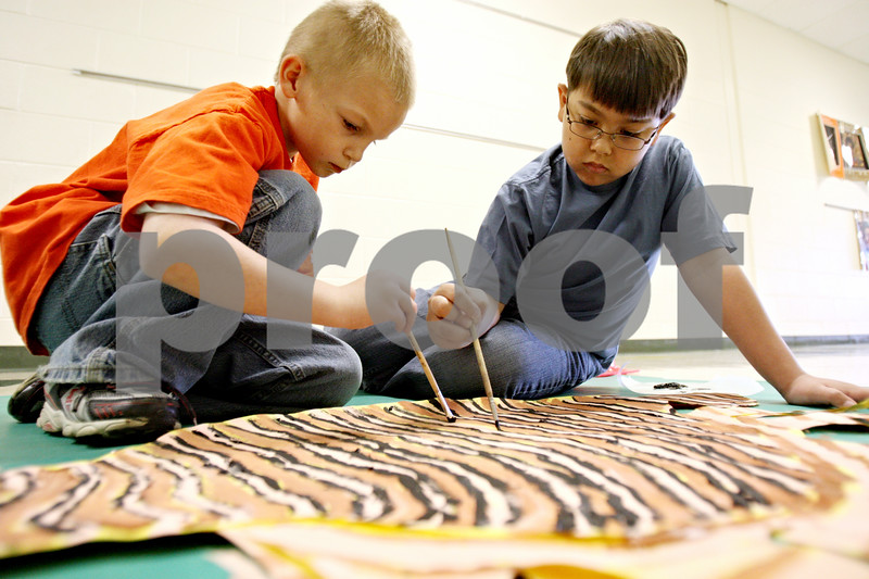 """Rob Winner – rwinner@daily-chronicle.com<br /> <br /> Dylan Reutz (left), 8, and Craig Croslow, 8, paint a bony fish at Gwendolyn Brooks Elementary School in DeKalb, Ill. on Tuesday March 30, 2010. This week local schools are celebrating Fine Arts Week and Brooks School's theme is """"Under the Sea."""""""