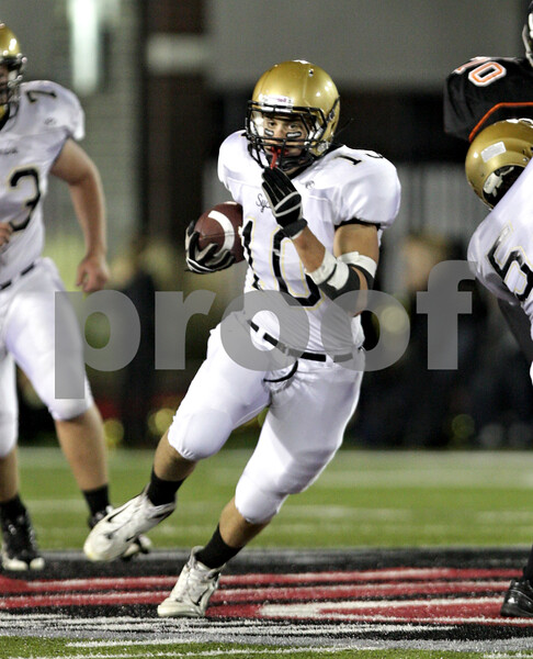 Beck Diefenbach – bdiefenbach@daily-chronicle.com<br /> <br /> Sycamore's Jordan Kalk (10) rushes with the ball during the second quarter of the Castle Challenge football game between DeKalb and Sycamore High Schools at Huskie Stadium on the campus of Northern Illinois University in DeKalb, Ill., on Friday Sept. 10 2010.