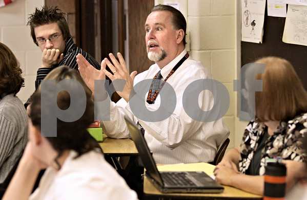 Kyle Bursaw - kbursaw@daily-chronicle.com<br /> <br /> DeKalb High School Principal Doug Moeller chimes in during a group discussion with teachers in the math department. Departments meet as a group every Wednesday in groups called Professional Learning Teams to discuss the ciriculum and other matters.