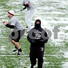 Rob Winner – rwinner@daily-chronicle.com<br /> <br /> Northern Illinois offensive lineman Keith Otis tries to keep warm during practice on Thursday afternoon at Huskie Stadium in DeKalb.