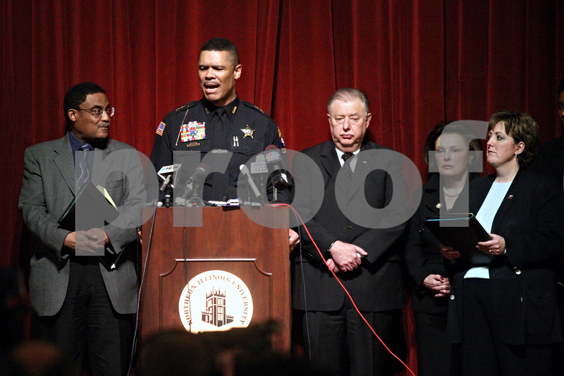 Northern Illinois University Police Chief Donald Grady (second from left) answers questions the day after the Feb. 14, 2008, campus shootings, during a news conference at Altgeld Hall on the DeKalb campus of the school. Also pictured are, from left, Executive Vice President of Finance and Chief of Operations Eddie Williams, NIU President John Peters, then-NIU Board of Trustees Chairwoman Cherilyn Murer and Assistant Vice President for Public Affairs Melanie Magara.