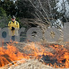 Rob Winner – rwinner@daily-chronicle.com<br /> <br /> Al Roloff, Natural Resources Manager for the DeKalb County Forest Preserve District, keeps a close eye on a controlled prairie burn at the Afton Forest Preserve in DeKalb, Ill. on Wednesday March 31, 2010.