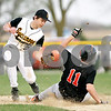 Beck Diefenbach  -  bdiefenbach@daily-chronicle.com<br /> <br /> Sycamore's Zack Spiewak (2) isn't able to tag DeKalb's Cody Varga (11) as he slides safe into second base during the top of the sixth inning of the game at Sycamore Park in Sycamore, Ill., on Tuesday April 6, 2010.