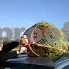 Mike Semeyn of Sycamore ties the tree he cut at Camelot Christmas Tree Farm in rural DeKalb to the roof of his car Sunday at the farm. Semeyn said he and his wife Barbara get a tree from the farm every year.<br /> <br /> Caitlin Mullen - cmullen@daily-chronicle.com