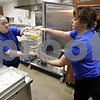 Rob Winner – rwinner@daily-chronicle.com<br /> Geness Warren (left) and Lisa Roelfsema begin preparing meals for the students of Cortland Elementary School in Cortland, Ill. on Friday February 19, 2010.