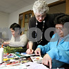 Rob Winner – rwinner@daily-chronicle.com<br /> Fe Guld (from front to back), of Sycamore, art therapist Lisa Kay and Eleanor Jesionowski, of Cortland, work on creating collages during the Healing Expressions class at the Kishwaukee Cancer Care Center in DeKalb, Ill. on Tuesday March 2, 2010.
